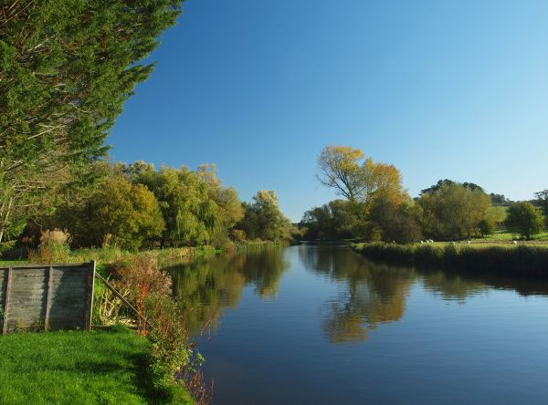 The peaceful River Avon at Upper Woodford